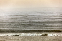 Heavy rain over the pacific ocean Stock Photo