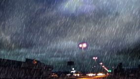 Heavy rain over road and light bulbs stock footage