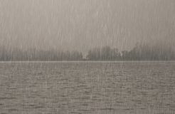 Heavy rain over the water. Heavy rain falling over the water Royalty Free Stock Photos