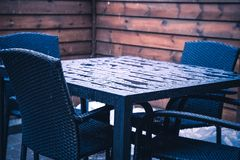 Heavy rain on patio furniture royalty free stock photography