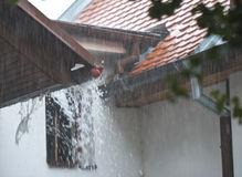 The heavy rain on the roof Stock Photography