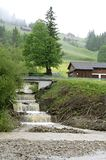 Heavy Rain in Swiss mountains due to climate change. Switzerland, on, at the foot of the the mountain pass, col Haggenegg there is situated the village Alpthal Stock Image