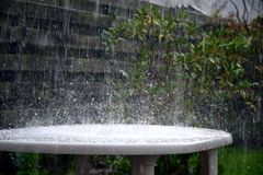 Heavy rain on table Stock Photography
