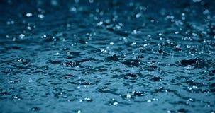 Heavy rain water drops on surface street Royalty Free Stock Photography