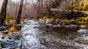 After heavy rainfall, abundant water flows through Oak Creek at Orchard Canyon. At Arizona SR89A between Sedona and Flagstaff in northern Arizona, United States stock images