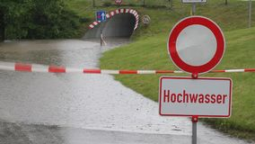 Flooded and closed road in Germany. During heavy rainfalls in June 2013 roads were flooded in Bavaria, Germany stock video