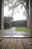 Heavy Rains In Backyard. View of heavy rains in backyard through open house door Stock Photo