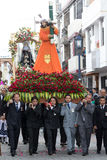 Heavy religious float carried by men in Ecuador. April 14, 2017 Cotacachi, Ecuador: heavy religious floats are being carried through the streets during Easter Stock Photos