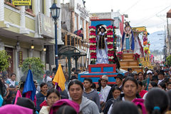 Heavy religious floats are being carried through the streets at Easter. April 14, 2017 Cotacachi, Ecuador: heavy religious floats are being carried through the Royalty Free Stock Images