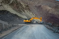 Heavy road construction car in Himalaya mountains Royalty Free Stock Images