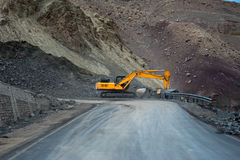 Heavy road construction car in Himalaya mountains. India, Ladakh Stock Images