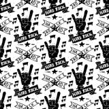 Heavy rock music badge vector vintage label with punk skull seamless pattern background hard sound sticker emblem. Heavy rock music badge vector vintage label Royalty Free Stock Photos