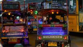 Heavy rush hour traffic. BANGKOK - JANUARY 31, 2018: Tuk-tuk takes tourists during heavy rush hour traffic in Bangkok on january 31, 2018 in Bangkok, Thailand stock footage