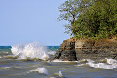 Heavy Seas. High winds create waves that crash up against Lake Erie's rocky cliffs in western New York State on a clear day Royalty Free Stock Photo