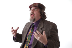 Heavy set man speaking and gesturing Stock Photography