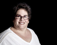 Heavy Set Middle-Aged Woman wearing Glasses in Studio Royalty Free Stock Photography