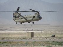 Heavy Sling load. CH-47 Chinook Sling Load in Afghanistan Stock Photo