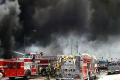 Heavy smoke over a fire scene. Heavy smoke hovers of the staging area of a fire scene Royalty Free Stock Photo
