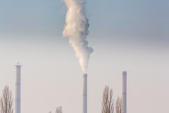 Heavy smoke pollution from coal power plant stacks Stock Image