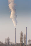 Heavy smoke pollution from coal power plant stacks Stock Photos