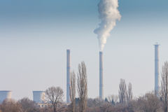 Heavy smoke pollution from coal power plant stacks Stock Images