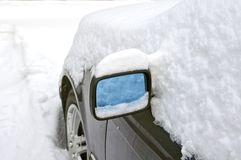 Heavy snow around car mirror Stock Images