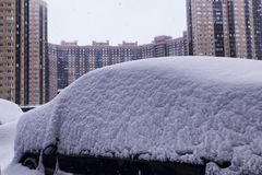Heavy snow in the city parked cars in the street on a snowstorm Winter Day stock photo
