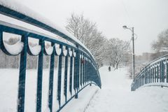 The railing of the bridge by a cap of snow. royalty free stock photography