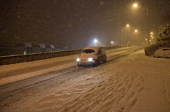 Heavy snow fall with passing traffic Stock Photo