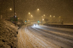 Heavy snow fall on road at night Royalty Free Stock Image