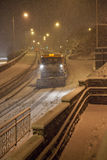 Heavy snow fall with snow plow / gritters Stock Image