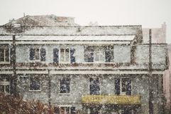 Heavy snow falls in a city. Blurred image royalty free stock images