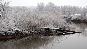 Heavy snow on the river. Winter weather stock video footage