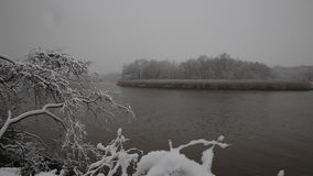 Heavy snow on the river. Winter weather stock video