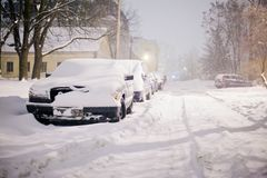 Heavy snow storm blowing in city streets of residential area royalty free stock photo