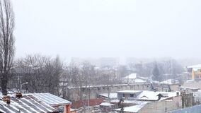 Heavy snow storm other the city. Slow motion stock video footage