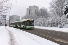 Heavy snow on the streets. Cars covered with snow. Ice on the road. stock photo