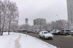 Heavy snow on the streets. Cars covered with snow. Ice on the road. royalty free stock photo