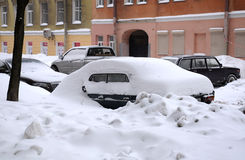 After a Heavy Snowfall. Cars under snow on the street of St.Petersburg in Russia during Russian Christmas holiday after a heavy snowfall Stock Photos