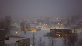 Blizzard in Tromso town. Heavy snowfall and blizzard over residential area of Tromso at dusk, Norway stock video footage