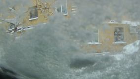 Snowfall in the city. Heavy snowfall in the city snowstorm drifts transport collapse stock footage