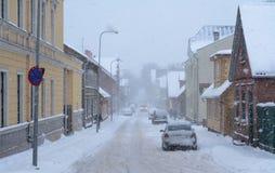 Heavy snowfall in city, some pedestrians and cars on the street. Viljandi, Estonia Stock Photos