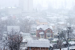 Heavy snowfall on a city street Stock Photos