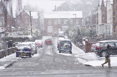 Heavy snowfall on a city street in the winter time of the year Stock Photos