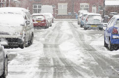 Heavy snowfall on a city street in the winter time of the year Royalty Free Stock Image