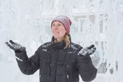 Young woman in the city in the snow stock photography