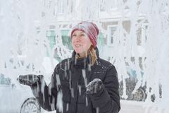 Young woman in the city in the snow stock images