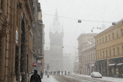 Heavy snowfall covering the Jindrisska Tower in Prague Royalty Free Stock Image