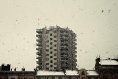 Heavy snowfall. Dense snowfall with snow flakes over an urban background Stock Photos
