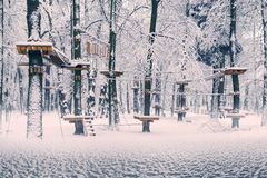 Snow-covered attractions in the old park royalty free stock photography